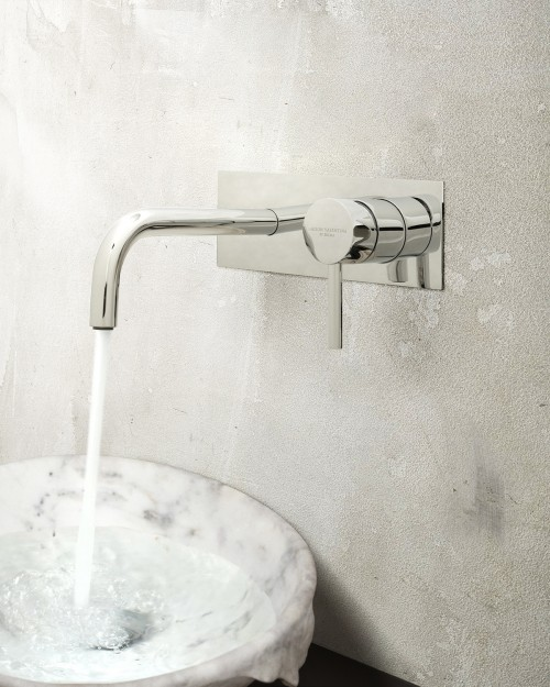bathroom-decoration-detail-with-flow-wall-mixer-tap-and-silk-vessel-sink