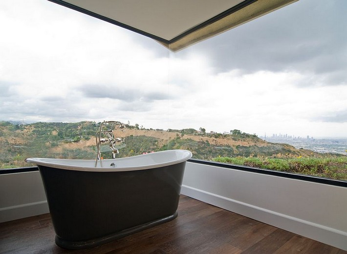 Creative Ideas to Transform Boring Bathroom Corners Stunning corner window brings the magic of landscape outside indoors