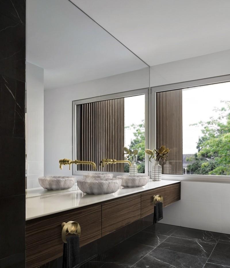 Contemporary interiors with distinctive bathroom designs by 4a Architekten 4a architekten Contemporary interiors with distinctive bathroom designs by 4a Architekten hotel bathroom with lotus vessel sink 1