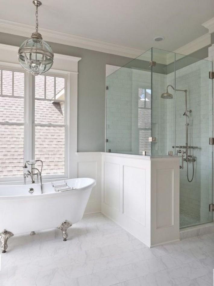 Airy-bathroom-with-white-silver-clawfoot-bath-tub claw foot bathtubs Graceful Claw foot Bathtubs That You'll Love Airy bathroom with white silver clawfoot bath tub