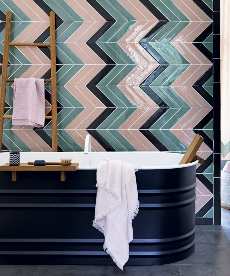 bathroom tile design Eye-Catching Bathroom Tile Design Ideas Bathroom with chevron tiles in green and pink